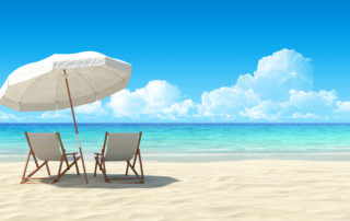Beach chair and umbrella on sand beach. Concept for rest, relaxation, holidays, spa, resort.